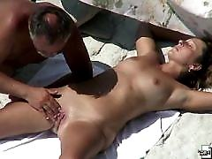 Horny nude hunk does his chick in the bushes